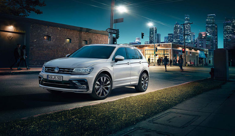 Looking for a family-sized car with plenty of room, full of style and drives really well? Look no further than the new VW Tiguan! The reviews have been fantastic about the 2016 specification and it's not hard to see why. This medium SUV comes with 5 doors and 5 seats, plenty of room for the family, the golf clubs or if you just like space, you'll find it hard not to love this revamped VW model. The stylish exterior means you'll stand out from the crowd and the interior is just as special. Take the dynamic roofline for instance; the optional panoramic glass sunroof fills the interior with light creating the illusion of a much bigger space whilst the new longer wheelbase (an extra 77mm) creates more legroom for rear-seat passengers. The back seats can also slide on runners by up to 170mm to release even more rear legroom or boot space. If boot space is your priority, you can drop the rear seats to revel in 1655 litres of square shaped load bay space! So what about the drive? The Tiguan has a selection of all-turbocharged engines, the petrol option provides 180bhp from its 2-litre engine or if you prefer a diesel car you'll be provided with 148bhp from its 2-litres. There's also the choice of 2 or 4-wheel drive. Whichever you choose you're in for a comfortable ride with the Tiguan, the light steering makes the drive around town a doddle yet it's easy to manoeuvre and grips confidently to the open road. If you're after the seven-speed dual clutch gearbox then you'll have to opt for the four-wheel drive option however, if it's fuel economy you're after then the six-speed manual with the 2-wheel drive will be the choice for you. There' no doubting that you'll be spoilt with the VW Tiguan, it certainly rivals the BMW X3 and the Volvo XC60. The chances are that these will be selling like hot cakes, and if you want a piece of the action why not get in touch today? We have great offers on the Tiguan and we're more than happy to talk through your leasing options with you. Give