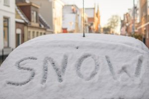 Car with snow on widscreen