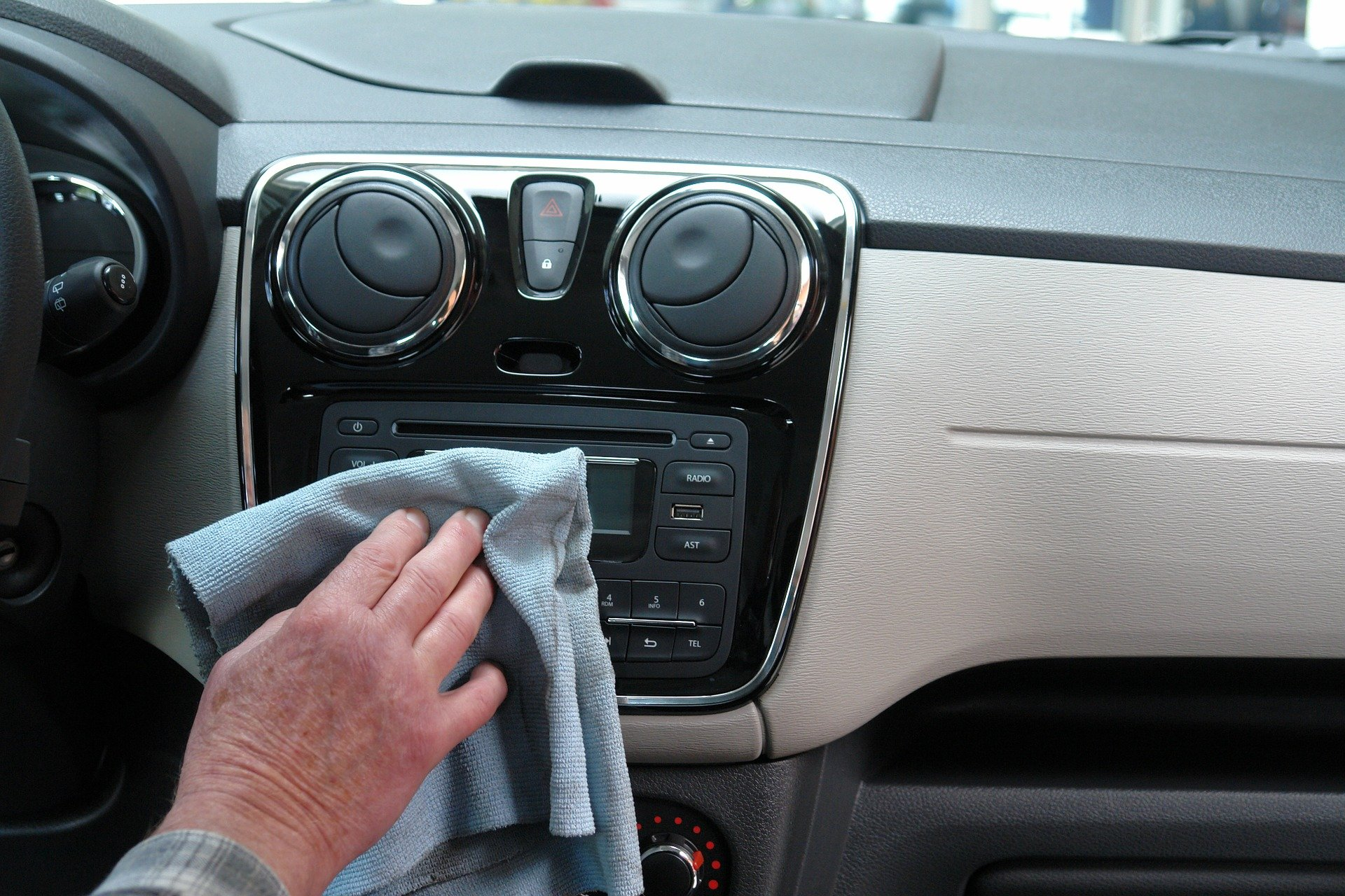 Person cleaning their car inside