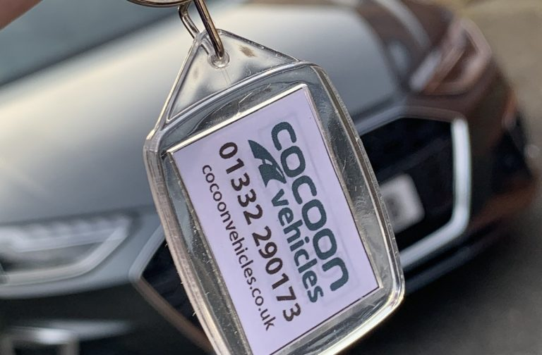 Cocoon Keyring in front of an Audi A4
