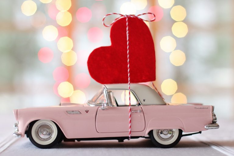 Pink car with a valentines heart on top